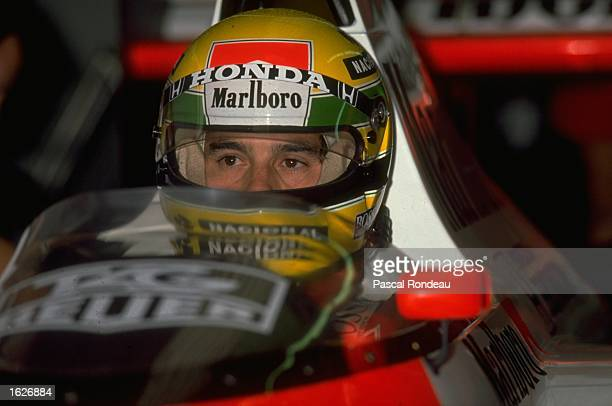 Portrait of Ayrton Senna of Brazil in his McLaren Honda before the Belgian Grand Prix at the Spa circuit in Belgium. Senna finished in first place. \...