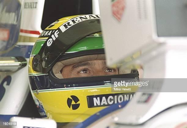 Portrait of Ayrton Senna of Brazil in his Williams Renault before the Brazilian Grand Prix at the Interlagos circuit in Sao Paulo, Brazil. Senna...