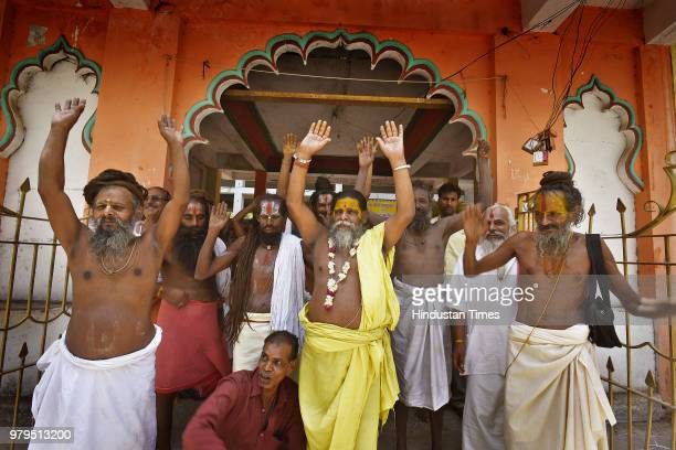 Portrait of Baba Laxman Das along with other sadhus at Ram Mandir Ashram on June 5 2018 Indore India One cannot become an ascetic because one has...