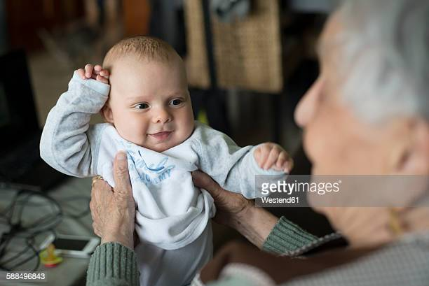Portrait of baby boy being held by his great-grandmother