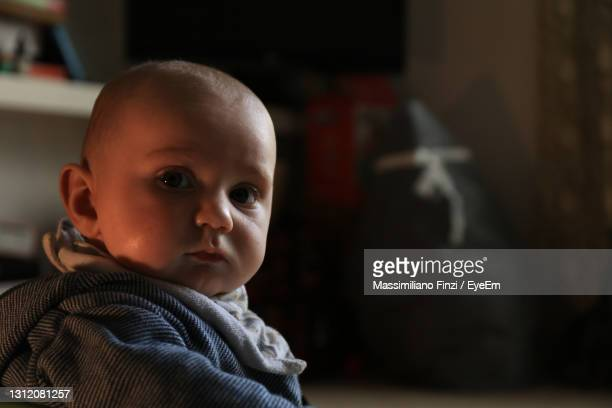 portrait of baby boy in a domestic room inside of the house - one baby boy only stock pictures, royalty-free photos & images