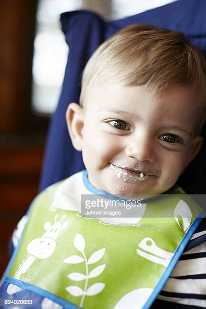 Portrait of baby boy in high chair