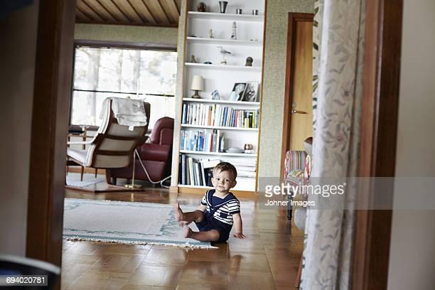 Portrait of baby boy in living room