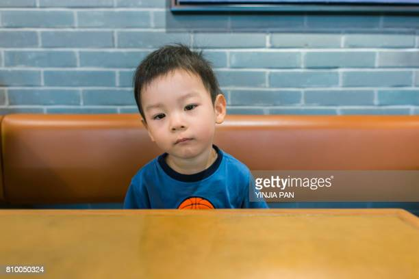 portrait of baby boy - impatient stock pictures, royalty-free photos & images