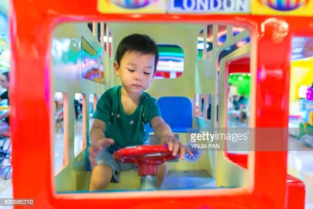 Portrait of baby boy playing toy car