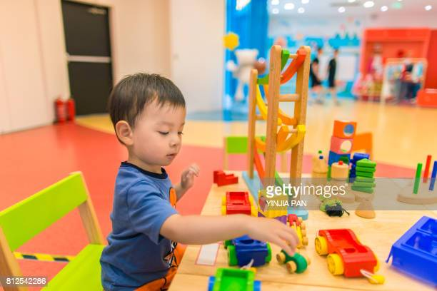 Portrait of baby boy playing toys