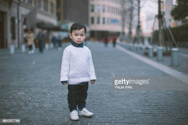 Portrait of baby boy walking in the street Shanghai China