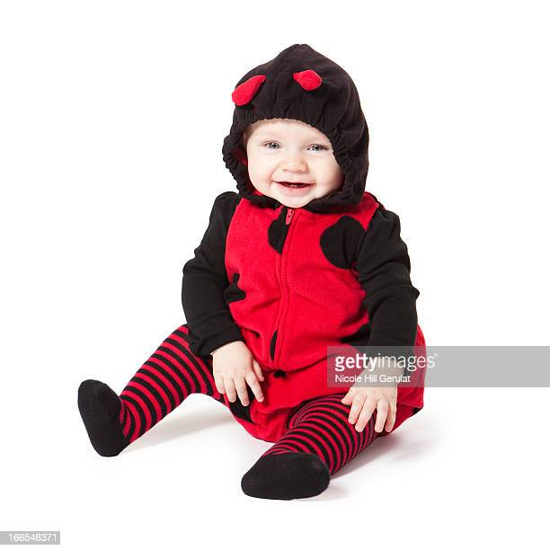 portrait of baby girl (6-11 months) in ladybird costume for halloween - 6 11 months stock pictures, royalty-free photos & images