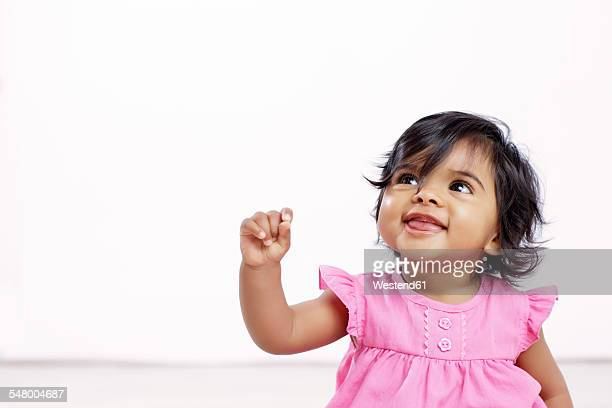 portrait of baby girl looking up - baby girls stock pictures, royalty-free photos & images