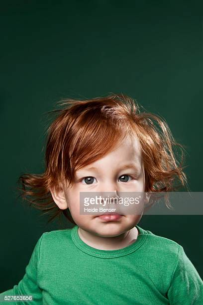 portrait of baby girl (12-23 months) with red hair - black ginger baby stock photos and pictures