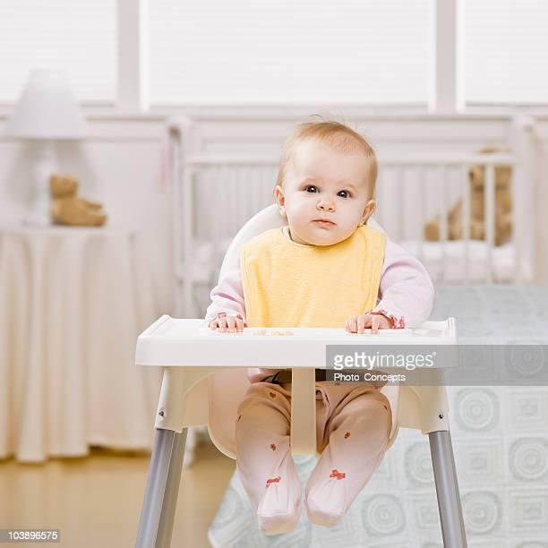 Portrait of baby in highchair