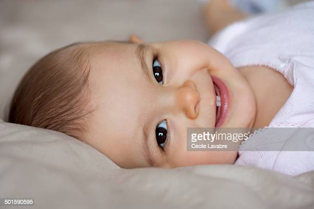 Portrait of baby lying and smiling