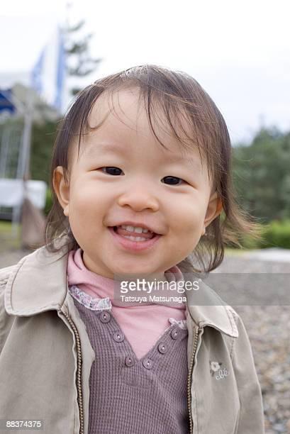 portrait of baby smiling  - 1歳以上2歳未満 ストックフォトと画像