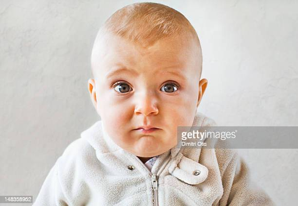 portrait of baby with funny confuse expression - guilt stock pictures, royalty-free photos & images