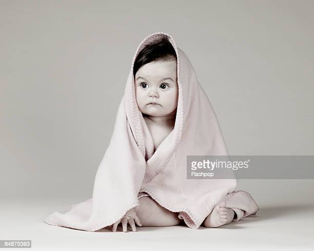 portrait of baby wrapped in blanket - eingewickelt stock-fotos und bilder
