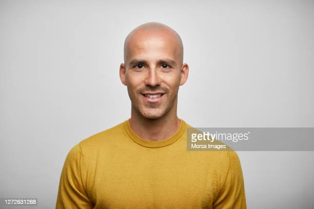 portrait of bald man standing on white background - studio shot stock pictures, royalty-free photos & images