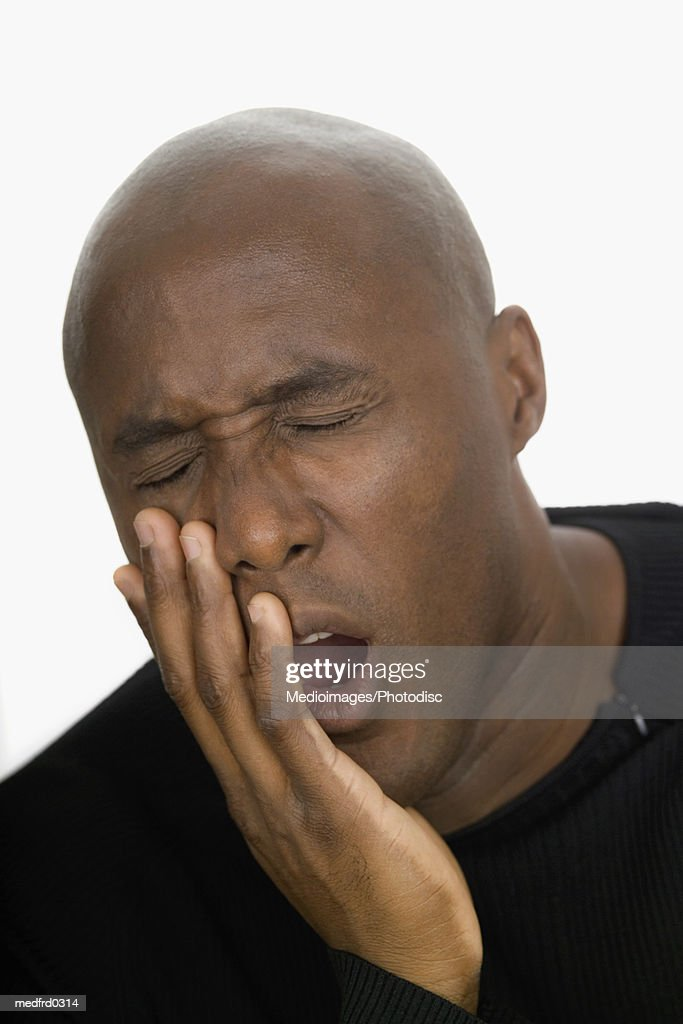 Portrait of bald man with toothache, close-up : Stock Photo