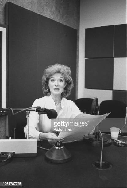 Portrait of ballet dancer and actress Moira Shearer reading a script in front of a radio microphone photographed for Radio Times following her...