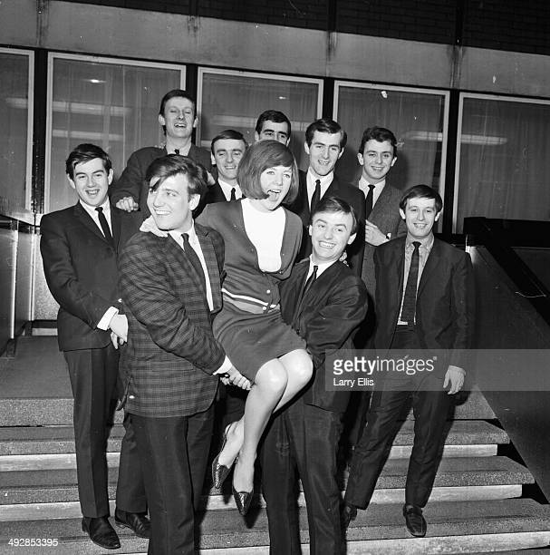 Portrait of bands 'Billy J Kramer and the Dakotas' and 'Gerry and the Pacemakers', holding up the singer Cilla Black, March 23rd 1964.