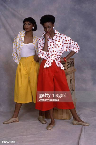 Portrait of Barbara Smith and an unidentified woman as the pair model polkadot tops and matched primarily colored skirts New York 1970s