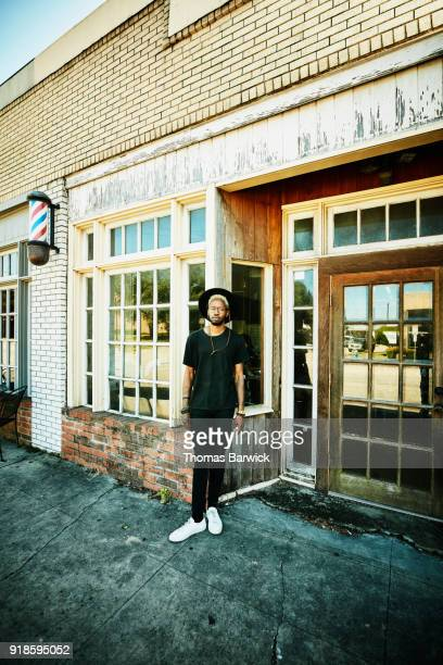 portrait of barber shop owner standing outside of shop - texas independence day stock pictures, royalty-free photos & images