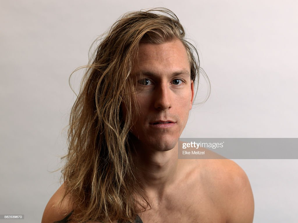 portrait of bare chested young man with long hair : Stock-Foto