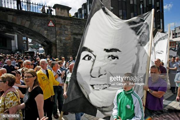 A portrait of Barney McGuigan the oldest person to be shot on Bloody Sunday is carried to the Guildhall in Londonderry where the findings of the...