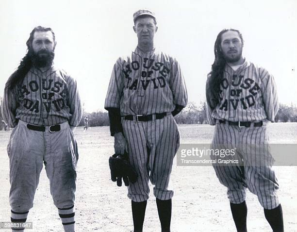 Portrait of baseball player Grover Cleveland Alexander as he poses with unidentified teammates from the barnstorming House of David team Benton...