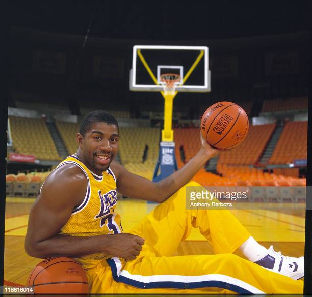 Portrait of basketball great Earvin Magic Johnson Jr point guard for the Los Angeles Lakers of the National Basketball Association dressed in uniform...