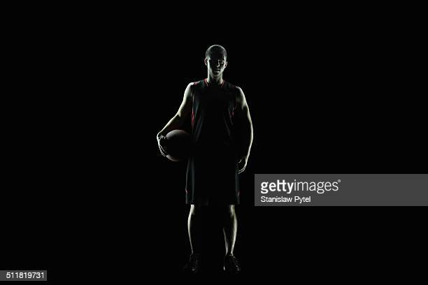 Portrait of basketball player, full body