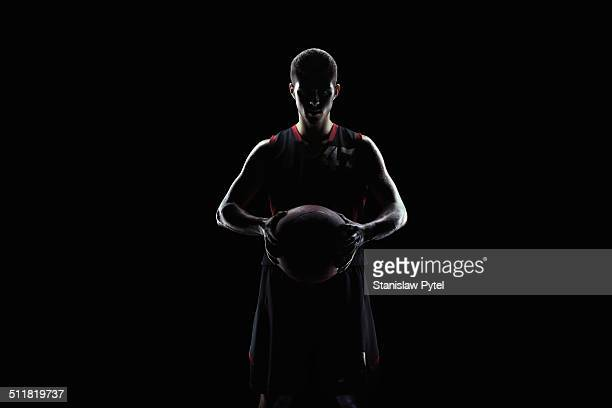 Portrait of basketball player holding ball