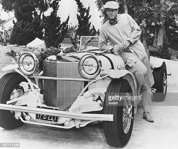 Portrait of 'Batman' actor Adam West with his replica 1929 Mercedes Benz SSK at his home February 22nd 1967