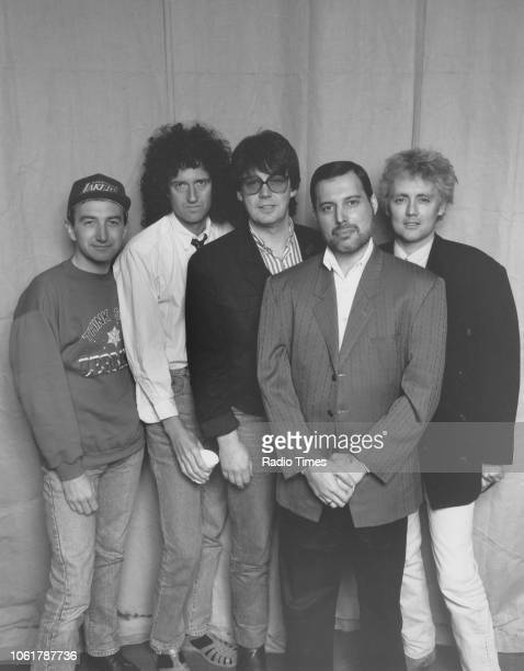 Portrait of BBC Radio 1 disc jockey Mike Read with the band 'Queen' John Deacon Brian May Freddie Mercury and Roger Taylor March 1989