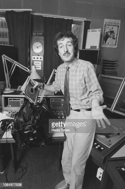 Portrait of BBC Radio 1 disc jockey Steve Wright in the studio August 1983
