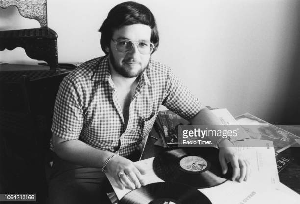 Portrait of BBC Radio announcer Charles Nove with his record collection September 11th 1981