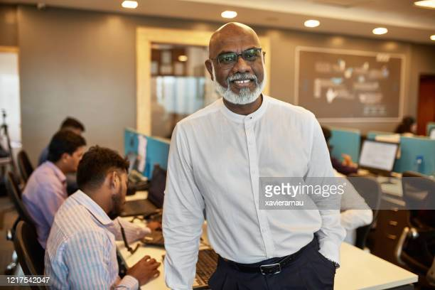 portrait of bearded 68 year old indian businessman - long sleeved stock pictures, royalty-free photos & images
