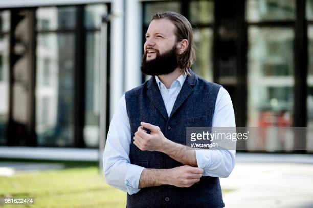 portrait of bearded businessman watching something - rolled up sleeves stock pictures, royalty-free photos & images