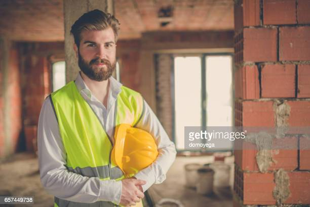 Portrait of bearded engineer wearing safety clothes