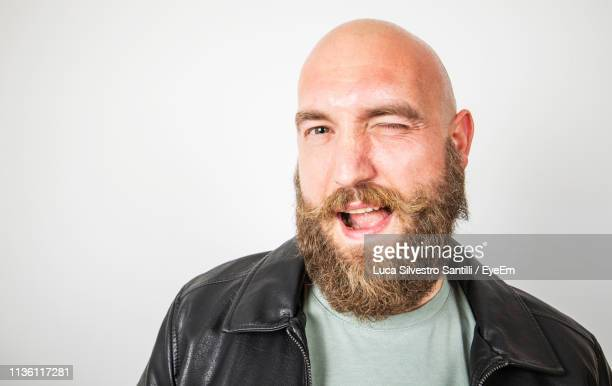 portrait of bearded man against white background - completely bald stock pictures, royalty-free photos & images