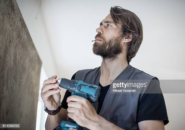 Portrait of bearded man fixing things at home