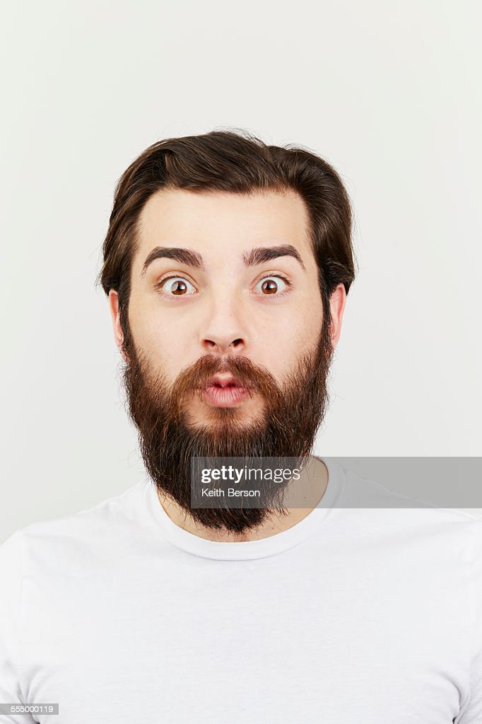 Portrait of bearded man in white t-shirt : Stock Photo