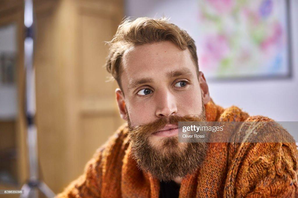 Portrait of bearded man looking sideways : Stock Photo