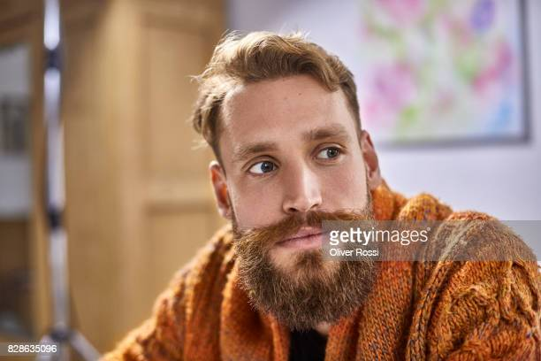 Portrait of bearded man looking sideways