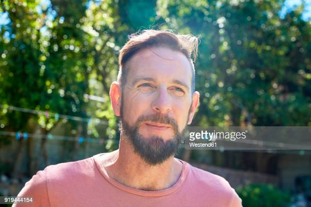 Portrait of bearded man outdoors