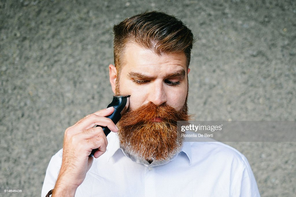 Portrait Of Bearded Man Trimming His Beard : Stock Photo