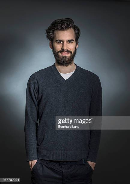 portrait of bearded man with hands in pockets - vネック ストックフォトと画像