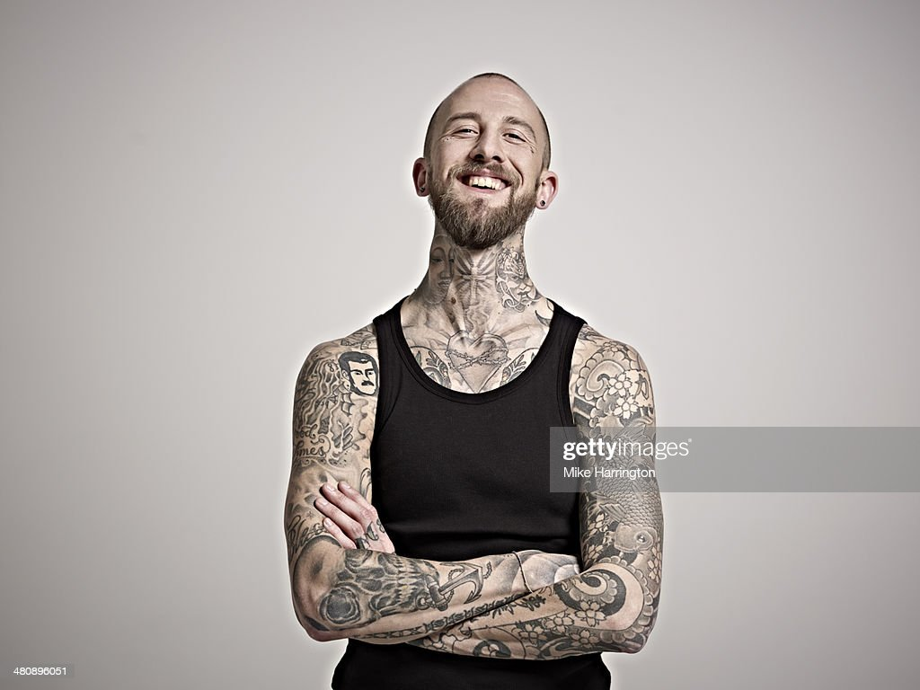 Portrait of bearded man with tattoos laughing. : Stock-Foto
