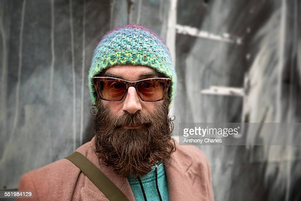 Portrait of bearded mature man with beanie and sunglasses