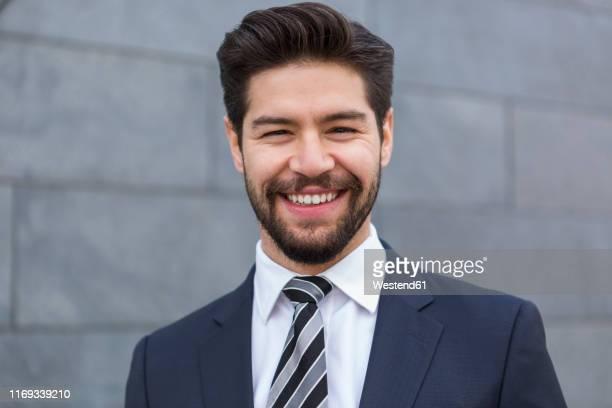 portrait of bearded young businessman - ポンパドール ストックフォトと画像