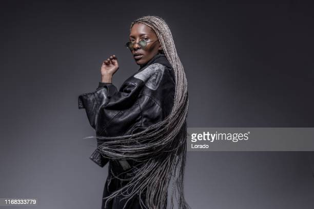 portrait of beautiful african woman wearing a leather jacket - jacket stock pictures, royalty-free photos & images